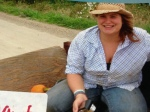 Apprentice Kristin rides in the wagon along with the pie pumpkins, 2011