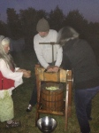 Paul, Anne, and friends grind apples to gress into cider.