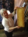 Anne showing what a good job the extractor does at releasing every bit of honey.