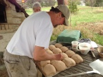 Scoring the loaves. The only three ingredients in these hearty packages are homegrown wheat, water and sea salt!