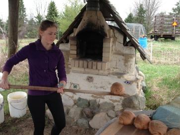 Annika unloads a loaf that she helped make!