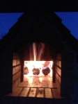 The fire in the brick bread oven is started late at night or early in the morning to warm the bricks.