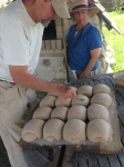 After mixing, kneading, proofing and shaping, Paul scores each loaf in his signature pattern.